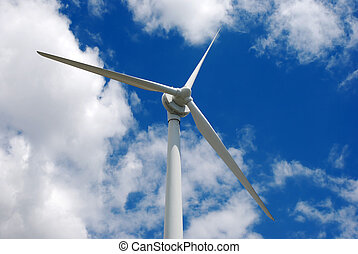 Wind energy turbine against the cloudy blue sky