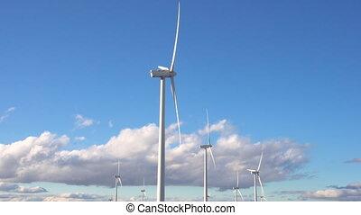 Wind energy turbines on blue sky background, sustainable...