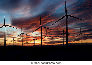 Wind Energy - Wind power landscape at sunset on a flat...