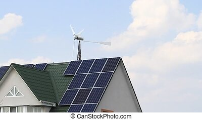 wind farm and solar panels installed on the house