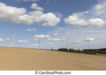 wind farm in the taunus region with plowed fields