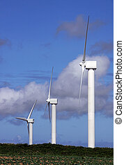 Wind farm turbine power generator masts and clouds