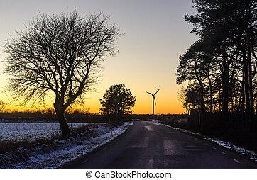 Wind generator by a country road in winter season