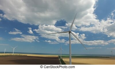 Wind generator converts the energy on the shore of the sea. Aerial survey