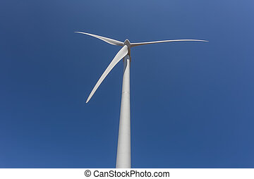 Wind generator, on a background of blue sky.