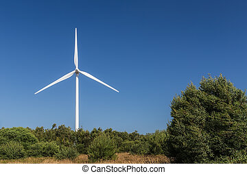 Wind generator on the background of the forest line.