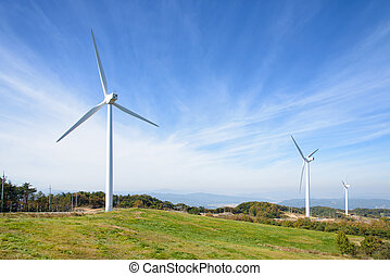 wind generator in a mountain with cloudy sky