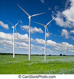 Wind generator turbine on spring landscape