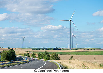 Wind generator turbine on summer landscape