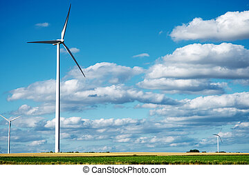 Wind generator turbines on summer landscape