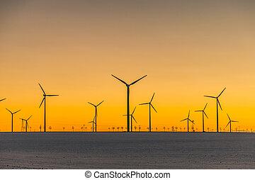 wind generators in sunset - many wind generators in sunset