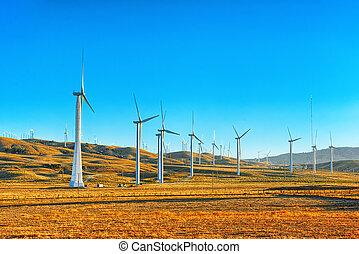 Wind generators in the endless fields. - Wind generators in...