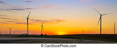 Wind generators of ecological power plant at sunset