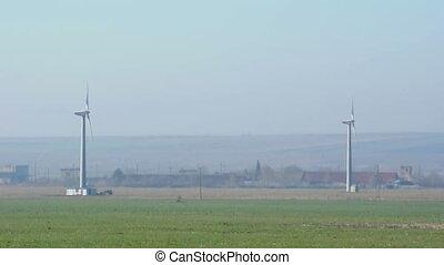 Wind generators on blue sky.