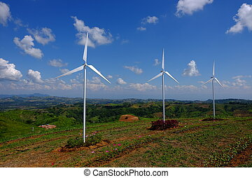 Wind generators turbines on sunset
