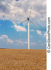 Wind generators turbines on wheat field