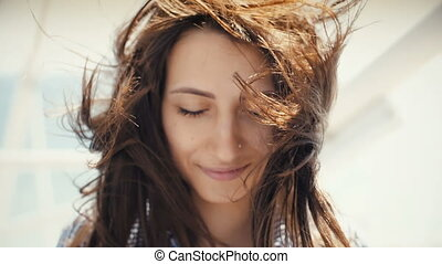Wind is playing with girls hair