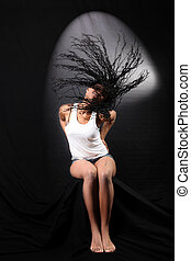 wind - lovely young afro-american woman with long flapping...