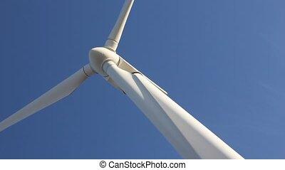 wind mill - wind turbine against blue sky