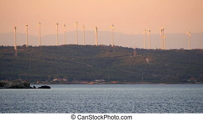 """Wind mill, windmill farm producing electricity great sunset"""