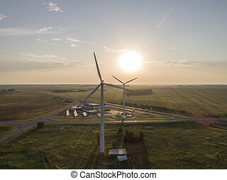 Wind mills during bright summer day alternative energy sources, wind power at sunset