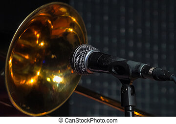Trombone in front of a microphone