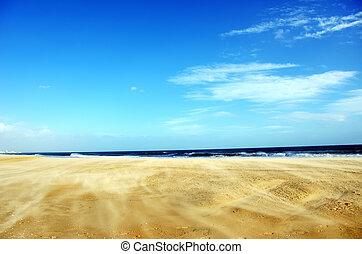 Wind on sand in Algarve beach, Portugal