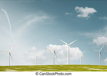 Wind park against smooth cloudy sky - Wind park on meadow ...