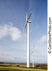Wind park - Wind turbine standing tall against the blue sky