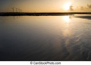 Wind power generator under sunset