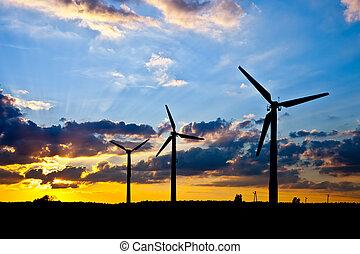 Wind power generators - Wind power landscape at sunset.