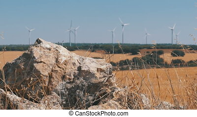 Wind power in the desert of Spain. Massive wind turbines...