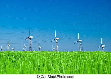 Wind power station - wind turbine against the blue sky