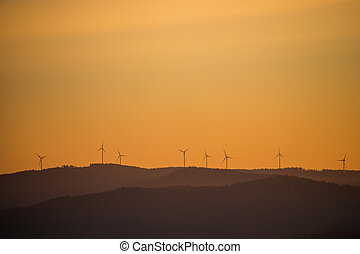 Wind power stations - wind turbines on the horizon, in the mountains