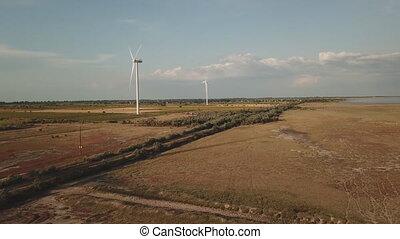wind power turbine dominant - aerial view of a wind turbine