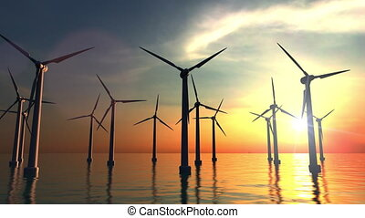 Wind power turbines at sea sunset. 4K dolly clip