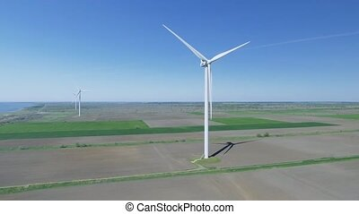 Wind power turbines in the field. Aerial view - Wind power...