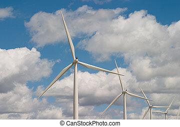 Wind Power - Wind turbines on a wind farm harvesting a...