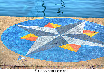 Wind rose painted on Alghero harbor. Heavy processed for hdr tone mapping effect.