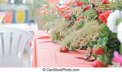 Wind Shakes Flowers and Tablecloth at Wedding Ceremony -...