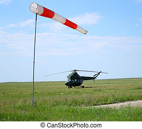 wind sleeve flying and helicopter airport outdoors