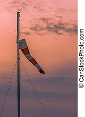 Wind sock against a colourful sunset