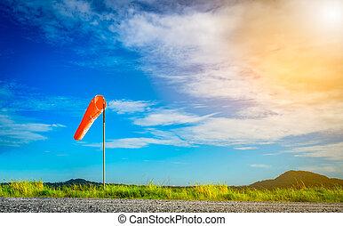 Wind sock on a pole with beautiful sky.