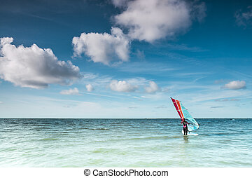 Wind surfer on a calm ocean at the North Sea