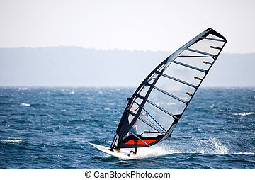 Wind Surfing - A wind surfer on the ocean