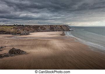 Wind swept Three Cliffs Bay