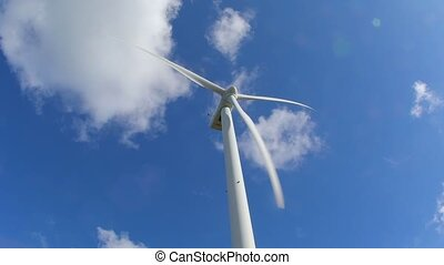 Wind tubine against blue sky - Wind tubine blades spinningin...
