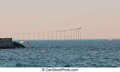 Wind tubines at sea - Offshore wind turbines at the sea in...