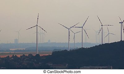Wind tubines in the distance - Many modern wind turbines...