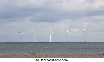 Offshore wind turbines at the sea in Copenhagen, Denmark